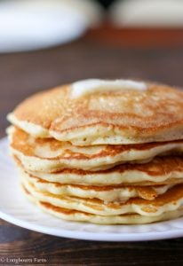 Side view of butter melting onto a stack of homemade pancake made from homemade pancake mix.
