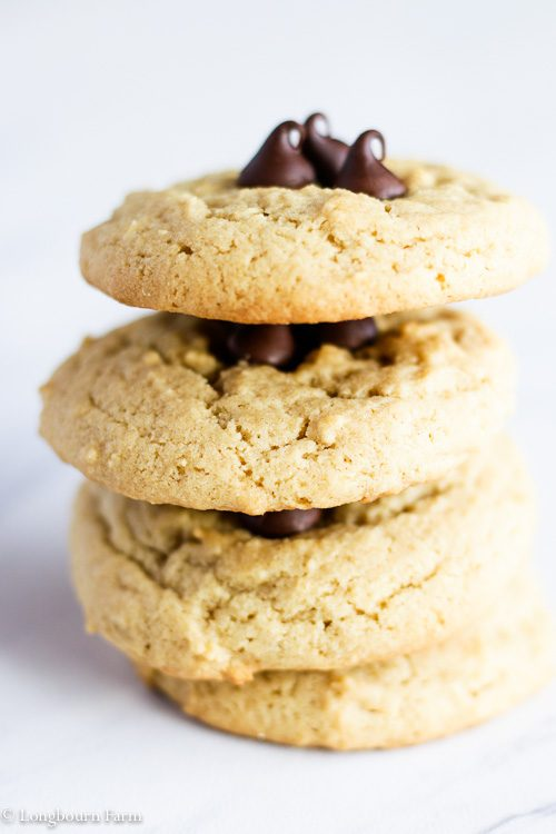 Leaning stack of soft peanut butter cookies.