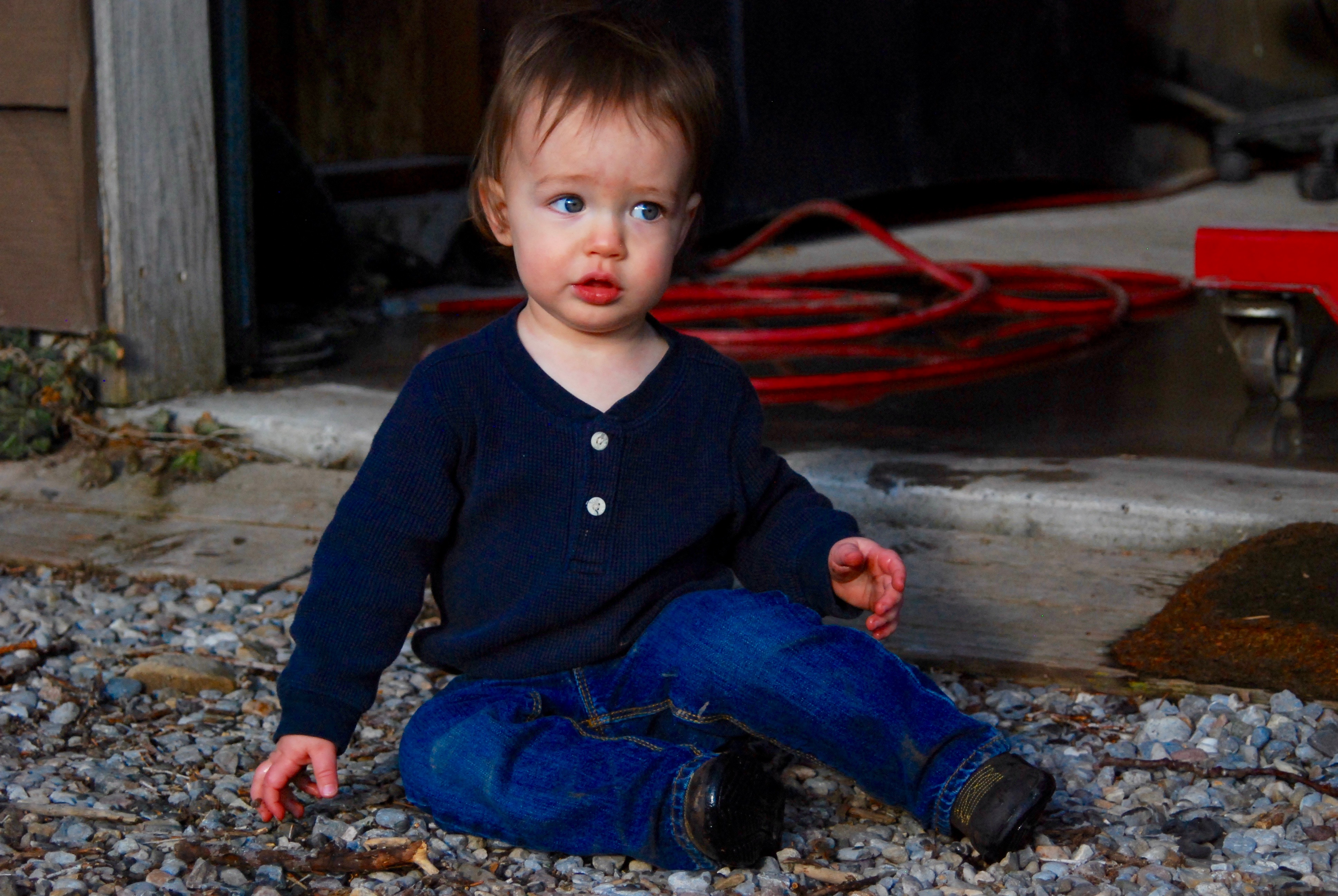 Abram sitting in the driveway
