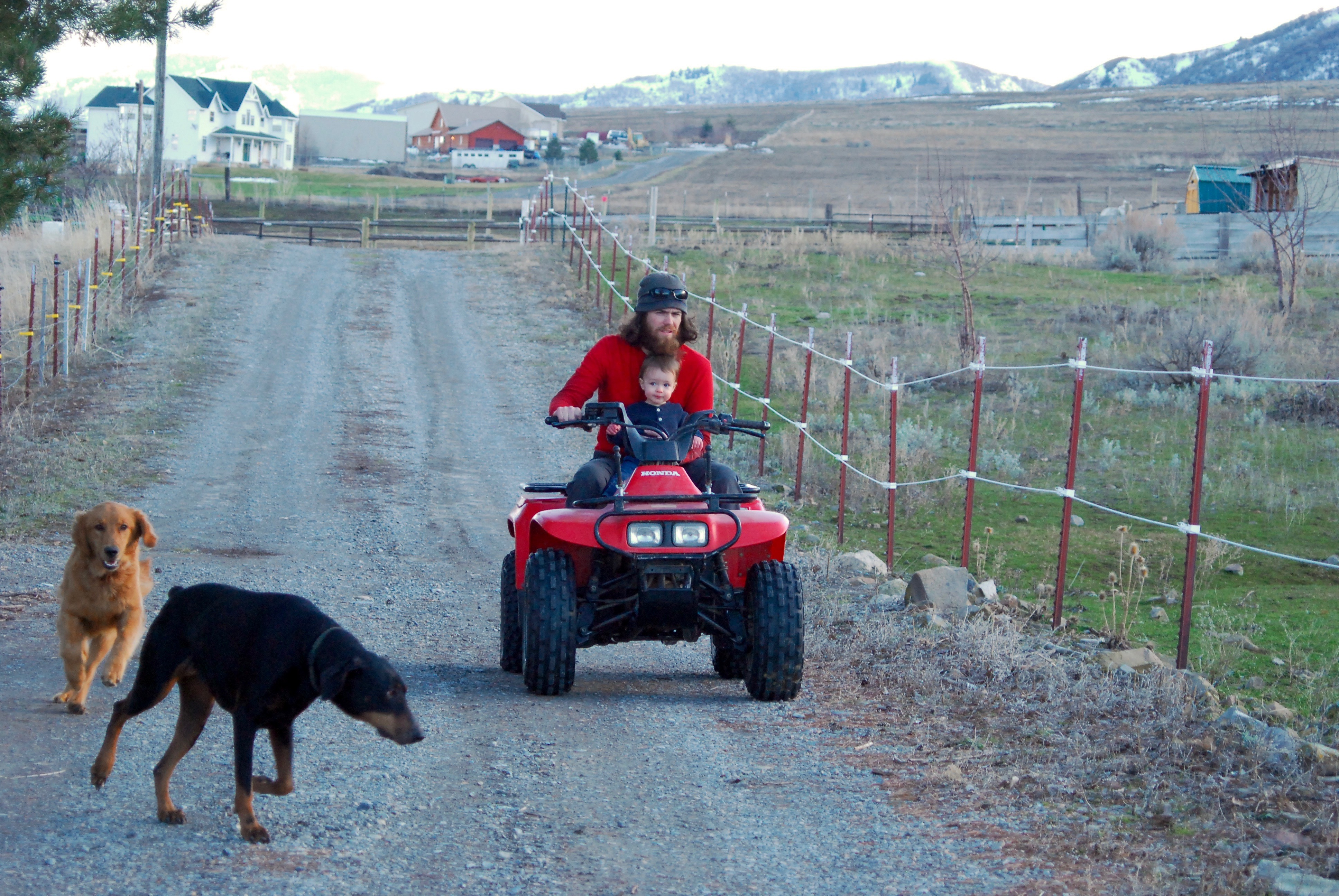 Andy riding the 4-wheeler with Abram