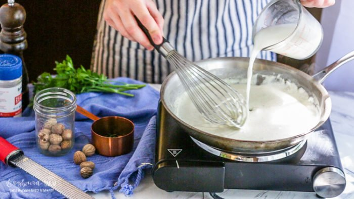 Thinning the easy homemade alfredo sauce with pasta water.