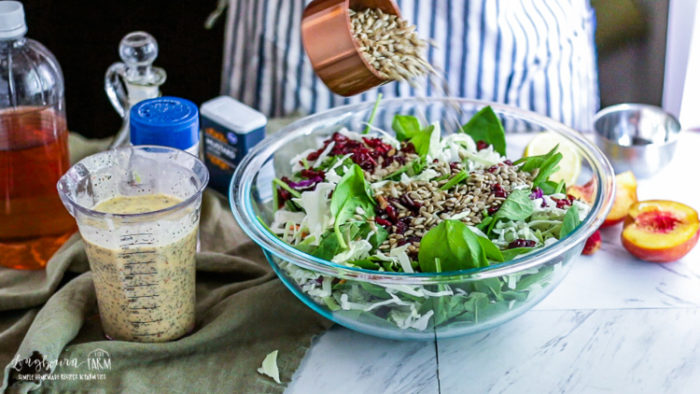 Adding sunflower seeds to the quick spinach salad.