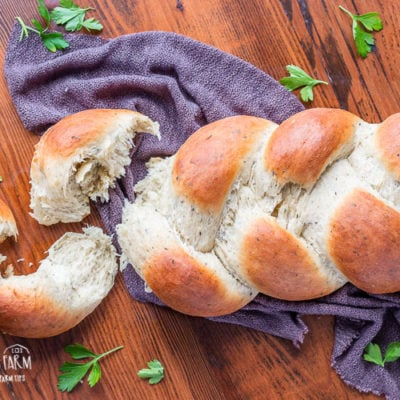 This 60 minute homemade herb bread is not only a showstopper, it's delicious and one of the easiest yeast breads you'll make! Perfect for any skill level! #herbbread #herbbreadrecipe #herbbreadrecipesimple #herbbreadrecipehomemade #herbbread #herbbreadsimple #herbbreadhomemade #herbbreadeasy #herbbreaditalian #herbbreadgarlic #herbbreadrosemary