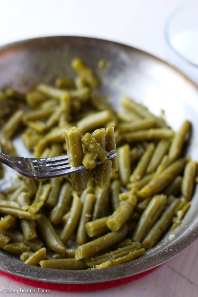 Canned green bean recipe green beans on a fork.