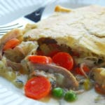 Slice of chicken pot pie from scratch on a white plate.