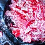 upclose aerial view of broken and dusty hard candy in a bowl