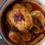Cooked rotisserie chicken in a pot.