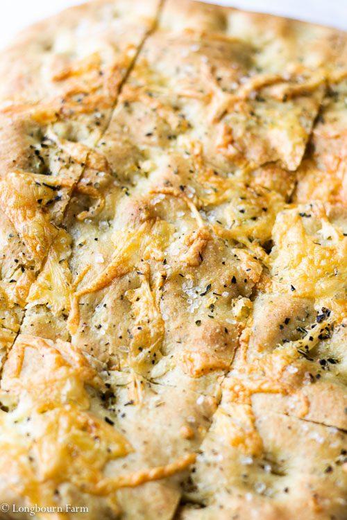 Close-up of sliced homemade focaccia recipe bread.