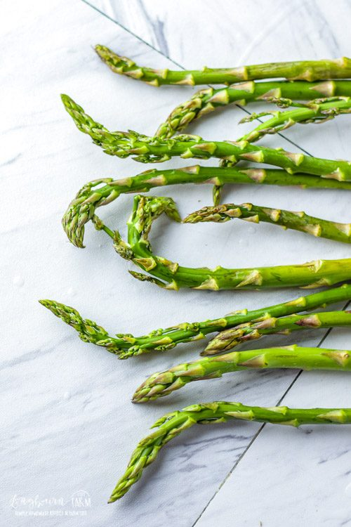 Top half of lined up asparagus spears.