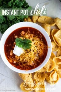 Instant Pot Chili is packed with flavor, easy to make, and family friendly!! This recipe can also be easily adapted for a slow cooker, either way you make it it's amazing! #instantpot #chili #instantpotchili #instantpotrecipe #chilirecipe #groundbeefchili #spicyfood #cornchips #cheese #sourcream #easychili #slowcookerchili