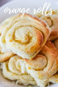 Orange rolls are an old classic recipe and perfect for any holiday dinner! These orange rolls are dripping with orange flavor and have just a touch of sweetness.#easter #christmas #rolls #yeastbread #orangerolls #orange #orangezest #orangeflavor #easyrolls #holiday #holidaymeal