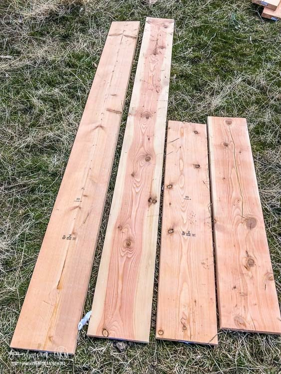 Cut wood assembled for raised planter garden bed.