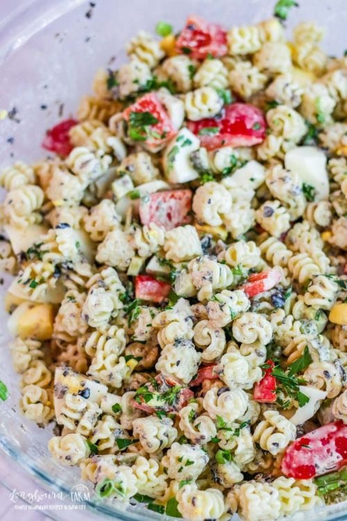 Large glass bowl full of easy macaroni salad recipe.
