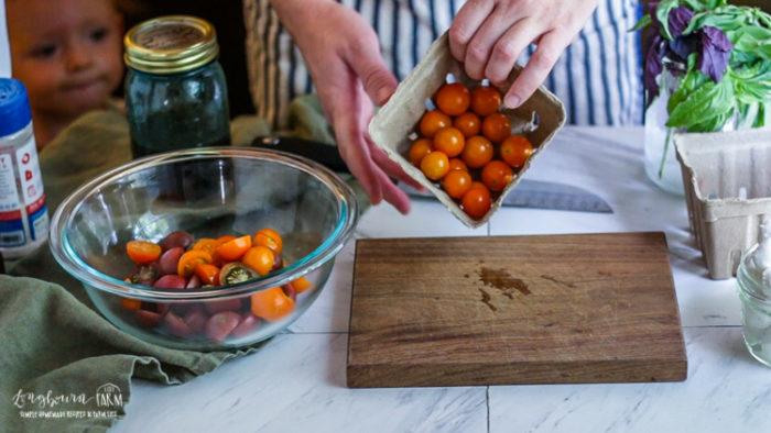 Adding cherry tomatoes for the cherry tomato salad recipe.