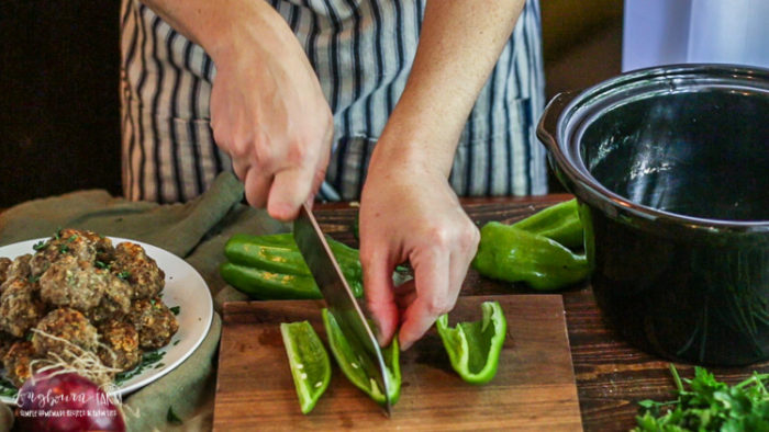 Slicing peppers for homemade Italian meatballs.