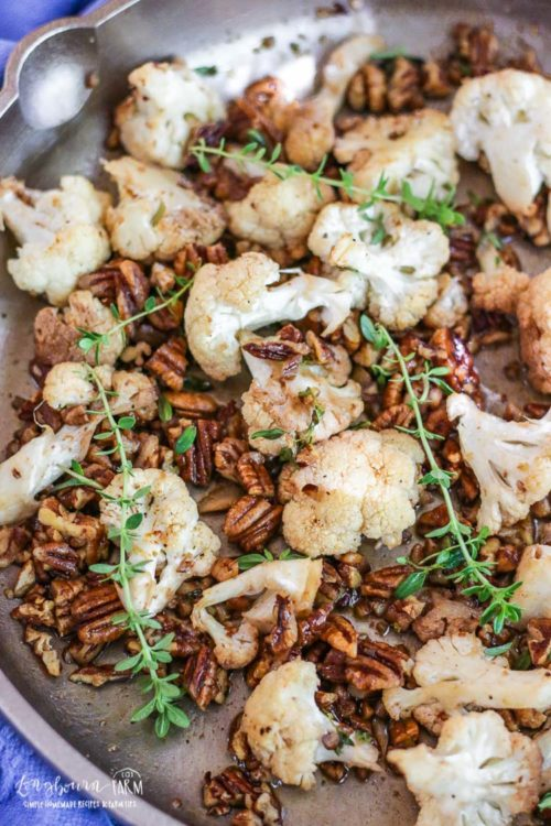 Perfect holiday side dish! Nut & Honey Roasted cauliflower is easy to make and keep warm until you serve your holiday feast! Check out this healthy, flavor-packed side dish! #longbournfarm #cauliflowerrecipes #cauliflowerrecipesroasted #roastedcauliflower #castironskilletrecipes #castironskillet #castironrecipes