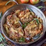 Bacon apple pork chops are packed with flavor and done in just 30 minutes! Everyone will love this incredible, one-pan recipe. #appleporkchops #appleporkchopsskillet #baconappleporkchops #porkchoprecipes #porkrecipes