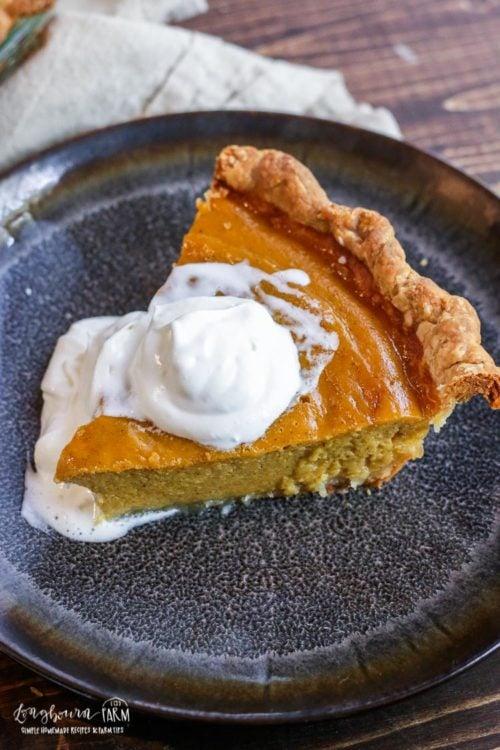 Homemade pumpkin pie on a plate.