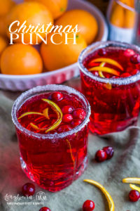 Bring your holiday dinner up a notch with this festive, family-friendly Christmas Punch recipe. Throw it together in minutes for a delicious Christmas drink! #christmaspunch #christmaspunchforkids #christmaspunchnonalcoholic #festivedrinknonalcholic