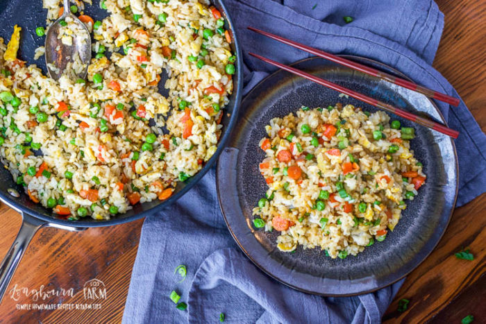 Easy fried rice is the perfect way to use up leftovers and create a flavorful, filling meal. Try it for lunch or dinner, stand-alone or as a side dish! #friedrice #friedricerecipe #friedricerecipeeasy #friedriceeasy #veggiefriedrice #vegetablefriedrice