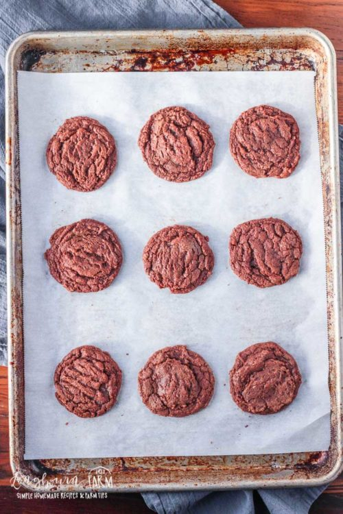 Homemade brownie cookies on a baking sheet.