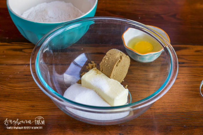 Butter and sugars in a glass bowl for candy cookies.