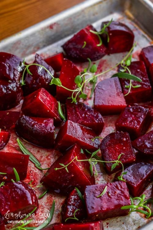 Roasted beetroot on a sheet tray.