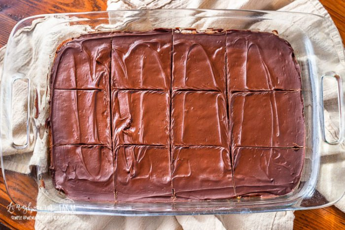 Sliced chocolate peanut butter cookie bars in a 9x13 pan.