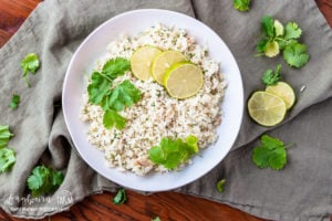 Cilantro lime rice in a bowl on a towel.