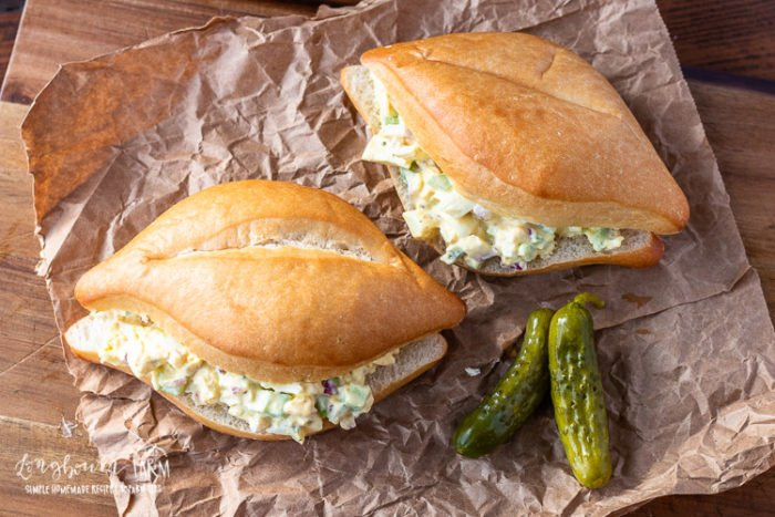 Super easy egg salad recipe! Perfect in a sandwich, on crackers, or all by itself. Toss it together in less than 30 minutes for a quick meal. #eggsaladrecipe #eggsaladsandwich #eggsaladeasy #besteggsalad #easyeggsalad #classiceggsalad #eggsaladwithpickles
