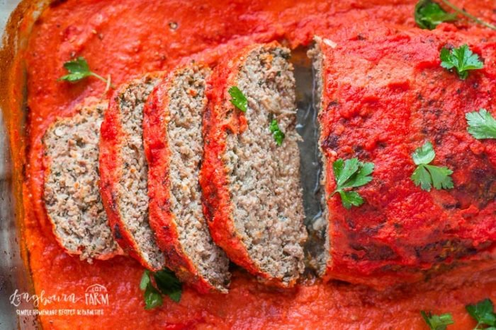 Sliced homemade meatloaf recipe in a 9x13 pan.