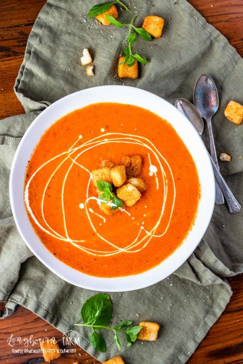 Homemade tomato soup is easy to throw together and is ready in 30 minutes. Use canned or fresh tomatoes, the flavor is perfect either way. #homemadetomatosoup #tomatosoup #homemadetomatosouprecipe #tomatosoupeasy #tomatosouphealthy #tomatosoupfreshtomatoes #tomatosouprecipe