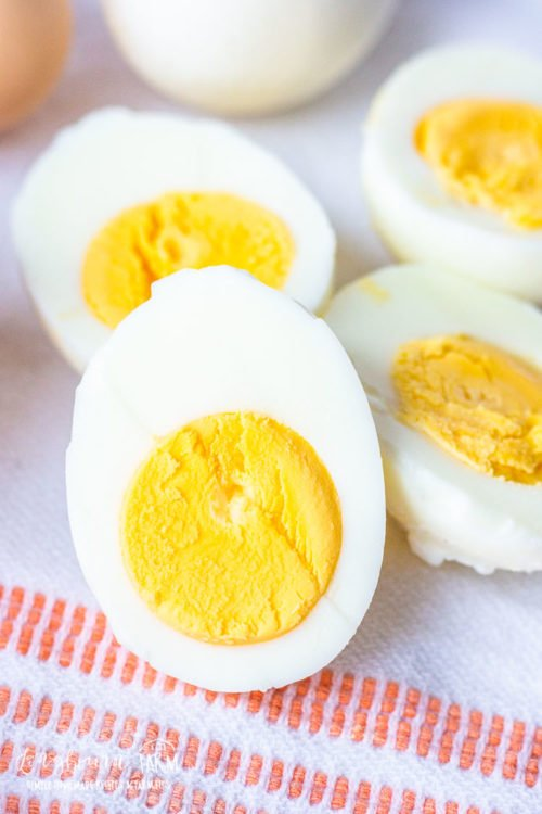 Learn how to cook hard boiled eggs perfectly every single time! This method is fool-proof. Get tips and tricks for easy peeling too! #hardboiledeggs #eggrecipe #boiledeggs #hardboiledeggspeeleasy #peeleasyeggs #perfecthardboiledeggs
