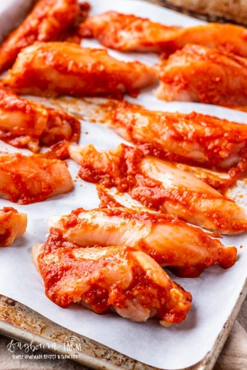 Chicken basted with bbq sauce for easy bbq chicken.