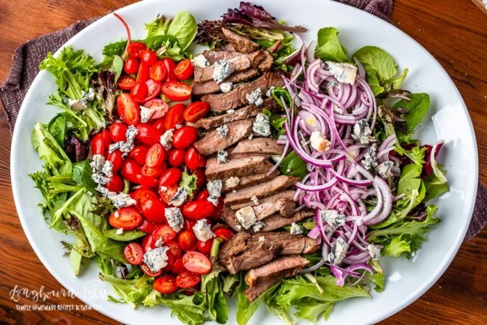 Steak salad ingredients with gorgonzola cheese.