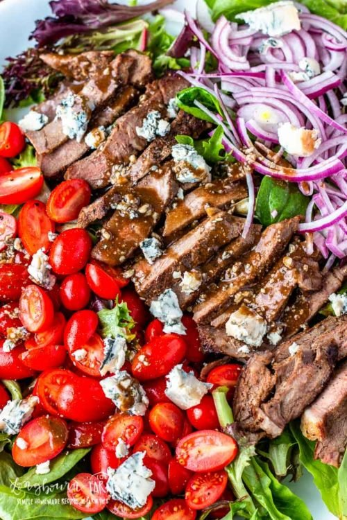 This steak salad recipe is a quick, delicious meal that's ready in minutes. The balsamic dressing is packed with flavor and the perfect pairing. #steaksalad #steaksaladrecipe #steaksaladdressing #steaksaladhealthy #steaksaladbluecheese #steaksaladeasy #steaksaladbalsamic