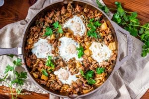This breakfast hash recipe is a perfect way to use up leftovers in your fridge. It couldn't be easier to make and is all done on the stovetop. #breakfasthash #breakfastrecipes #breakfasthashrecipe #breakfasthaseasy #skilletbreakfasthash #breakfasthash #breakfasthashbest