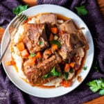 Making braised beef short ribs in the slow cooker is so incredibly easy and delicious! This cooking method gives fall off the bone and flavorful results every time. #shortribs #beefshortribs #beefshortribsslowcooker #beefshortribscrockpot #beefshortribsbraised #beefshortribseasy #beefshortribsbonein #beefshortribsbest #beefshortribsrecipe #beefshortribshowtocook