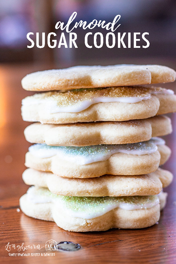 Almond sugar cookies are a fun twist on classic soft sugar cookies. Cut out your favorite shapes and decorate with an easy sugar cookie icing. #almondsugarcookies #sugarcookiessoft #sugarcookieicing #sugarcookieseasy #sugarcookierecipe #almondsugarcookierecipe #sugarcookiecutouts