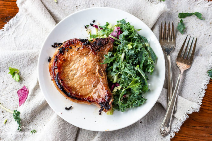 Asian pork chops plated with salad.
