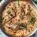 Creamy garlic tuscan chicken in a skillet.