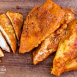Sliced and whole dutch oven bbq chicken breasts.