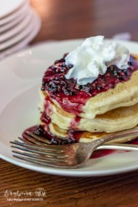 Making homemade blackberry syrup is so easy and quick! It is perfect on pancakes, cheesecake, just about anything.Whip up a batch today! #homemadesyrup #blackberries #blackberrysyrup #syrup #breakfast #breakfastrecipe #blackberrysyruprecipe #blackberrysyruppancakes #blackberrysyrupcanning