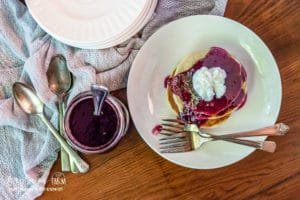 This blueberry syrup recipe is a simple and easy way to to take ordinary pancakes over the edge! Serve it on top of anything to really amp up breakfast.#blueberry #blueberryrecipes #blueberrysyrup #blueberrysyruprecipe #blueberrysyrupeasy #blueberrysyrupforpancakes #breakfast #pancakes #pancakesyrup #pancakerecipe