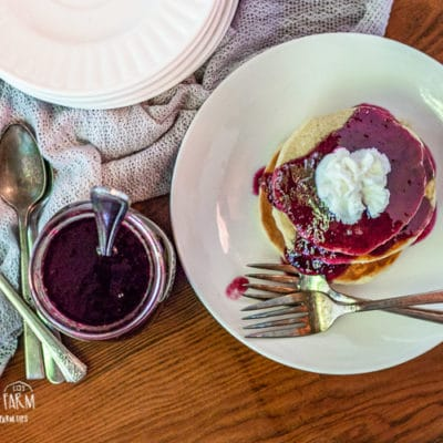 This blueberry syrup recipe is a simple and easy way to to take ordinary pancakes over the edge! Serve it on top of anything to really amp up breakfast. #blueberry #blueberryrecipes #blueberrysyrup #blueberrysyruprecipe #blueberrysyrupeasy #blueberrysyrupforpancakes #breakfast #pancakes #pancakesyrup #pancakerecipe