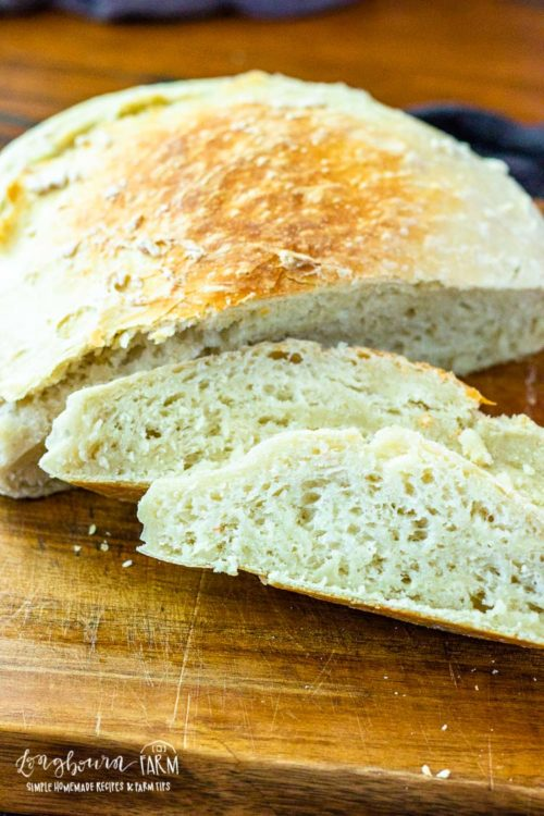 No knead dutch oven bread is so easy to make and turns out perfectly every time, even if you are a beginner. Bake this with coals or in the oven, it's amazing either way! #noknead #breadbaking #dutchoven #castironcooking #castiron #bakingincastiron #dutchovenbread #nokneadbread #dutchovenbreadeasy #dutchovenbreadrecipe