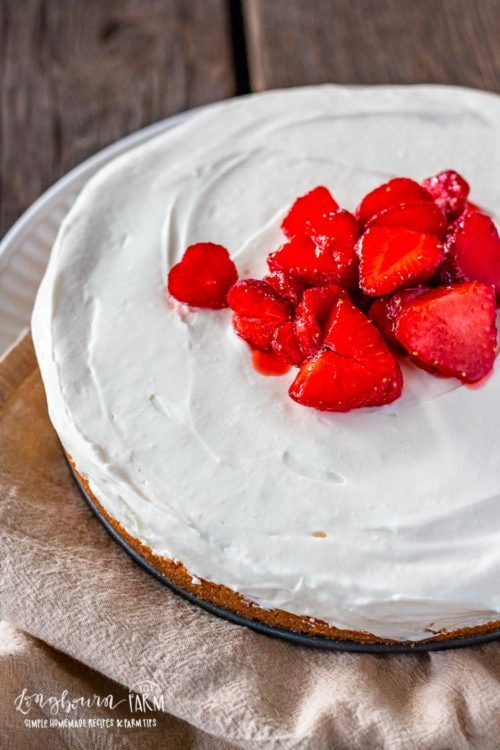 Easy no bake cheesecake topped with strawberries.