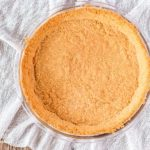 Making a homemade graham cracker crust is so easy! 15 minutes to delicious homemade crust ready for your favorite pie filling. #grahamcrackercrust #grahamcrackercrustrecipe #grahamcrackercrusteasy #grahamcrackercrustnobake #bakedgrahamcrackercrust
