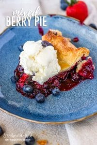 Homemade berry pie is a classic all year round no matter the occasion. It's a perfect balance of sweet and tart and packed with berry flavor! #tripleberrypie #mixedberrypie #easyberrypie #berrypiefilling #berrypierecipe #freshberrypie #bestberrypie #raspberrypie #blueberrypie #blackberrypie #strawberrypie #mixedberrypierecipe #easymixedberrypie