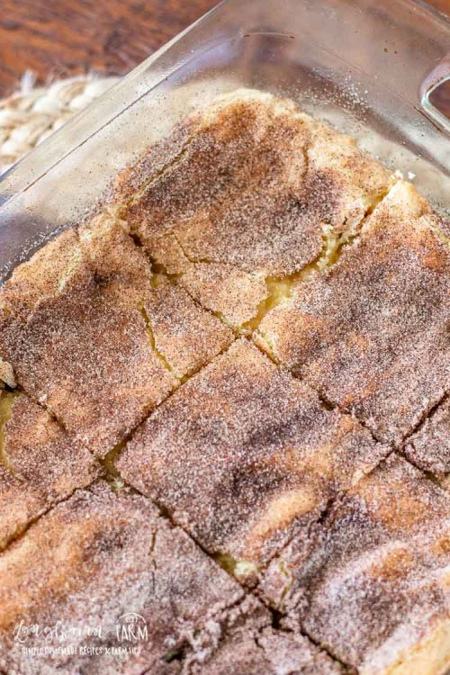 Close-up of sliced snickerdoodle bars in the pan.